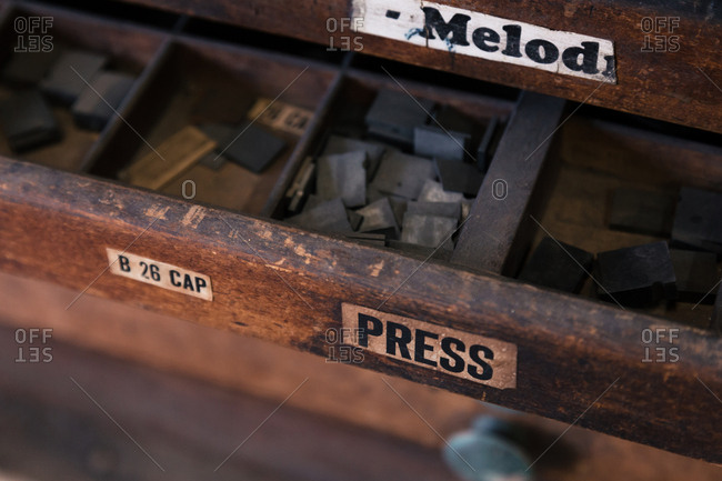 Trays of printing letters in letterpress shop