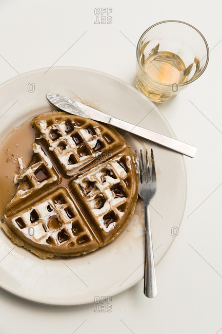 Overhead view of waffles and whiskey