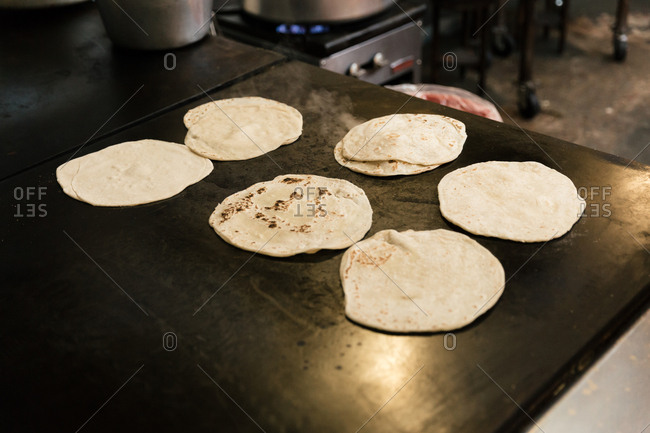 Tortillas being cooked in a restaurant