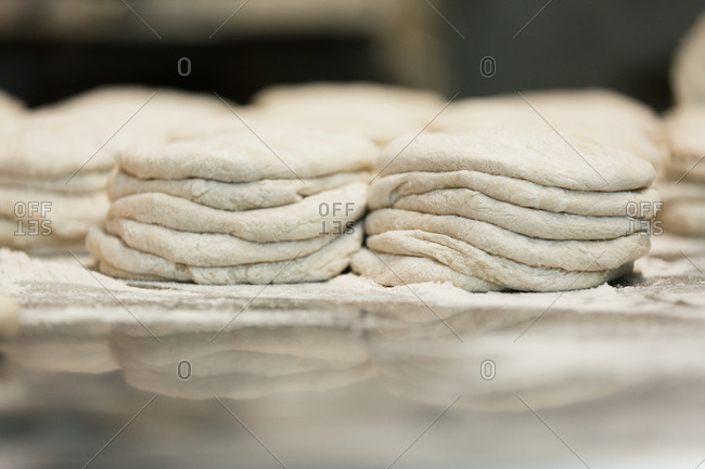 Close up of stacks of uncooked tortillas