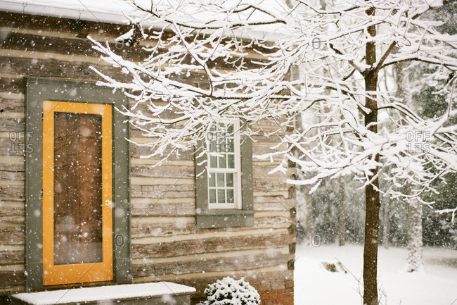 Contemporary log cabin in January snowstorm