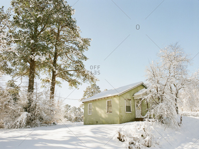 Quaint secluded cottage in rural North Carolina after winter snowstorm