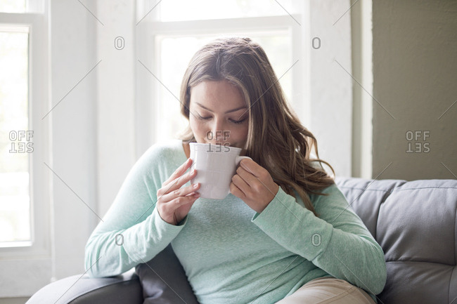 Woman drinking hot drink from a mug