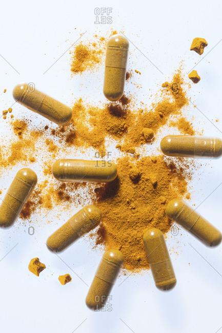 Turmeric supplement capsules and powder