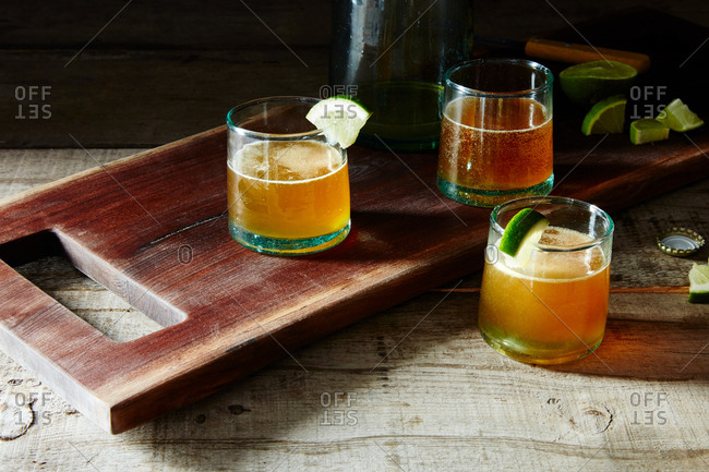 Beer and mezcal cocktail with lime agave and dashes of hot sauce and Worcestershire sauce