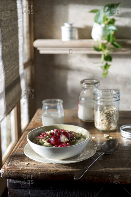 Breakfast table with muesli, milk, yogurt and fruit