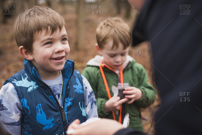 Boys learning about nature and environment in forest, Bristol, Rhode Island, USA
