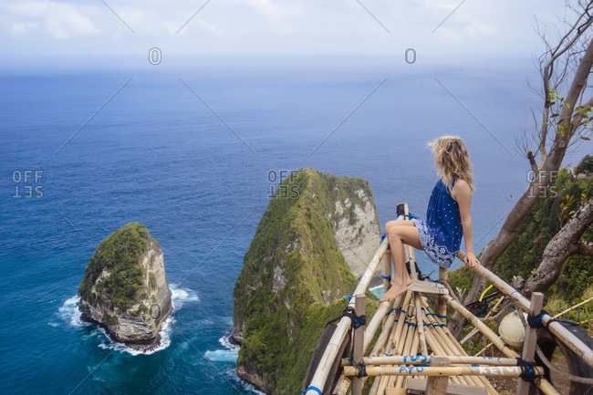 Adult woman admiring coastline of Nusa Penida island, Bali, Indonesia