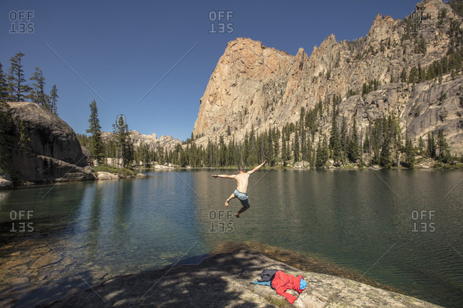 Man jumping into one of Saddleback Lakes, Sawtooth Mountains, Sawtooth National Recreation Area, Stanley, Idaho, USA