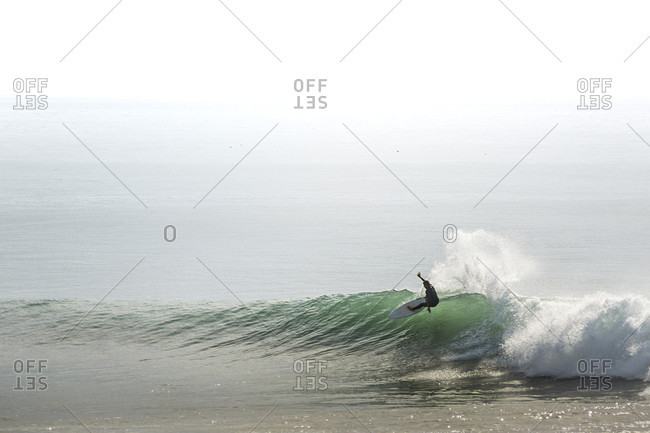 Surfer riding wave, Mill Valley, California, USA