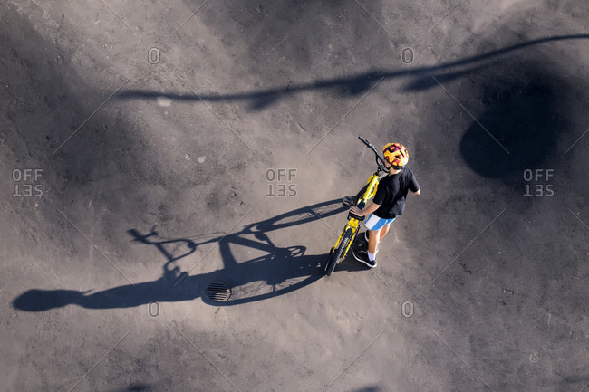 Boy with BMX bike in skate park, Canggu, Bali, Indonesia