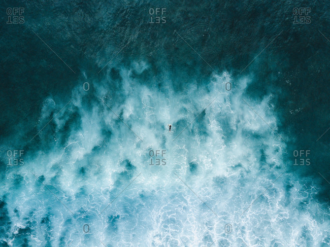 Aerial view of paddling surfer in sea, Tenerife, Canary Islands, Spain