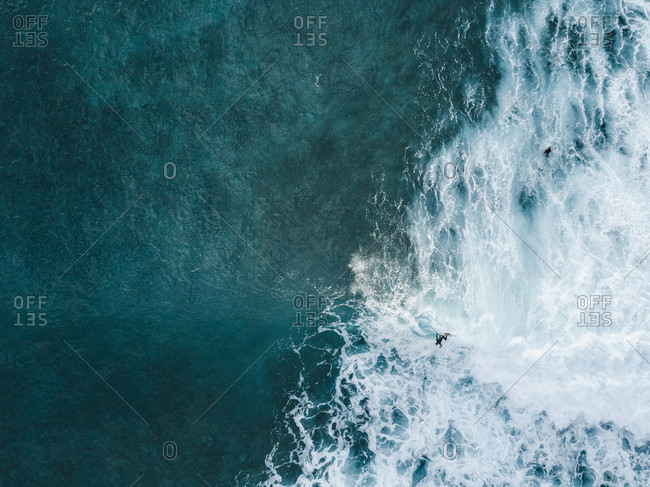 Aerial view of surfer catching wave in sea, Tenerife, Canary Islands, Spain