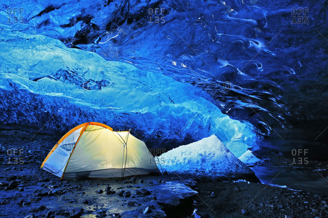 Tent in Crystal Cave, ice cave in Vatnajokull icecap, Iceland