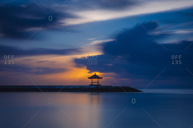 Sunset over sea and pavilion, Denpasar, Bali, Indonesia