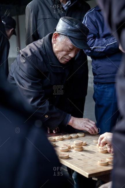 Beijing, Beijing, China - March 21, 2017: Man playing Chinese chess (Xiangqi), Temple of Heaven, Beijing, China