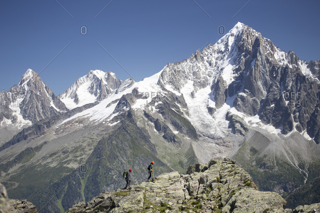 Chamonix, Haute Savoie, France - August 18, 2014: Two mountaineers on a rocky ridge high above Chamonix in the French Alps
