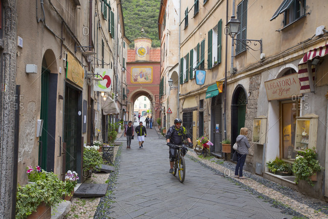 Finale Ligure, Liguria, Italy - February 16, 2018: Street in old town of Finalborgo, Finale Ligure, Province of Savona, Liguria, Italy