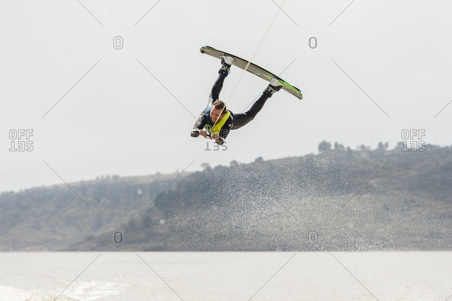 Aculco, Estado de Mexico, Mexico - November 13, 2012: Wakeboarder performing high jump against sky, Aculco, State of Mexico, Mexico