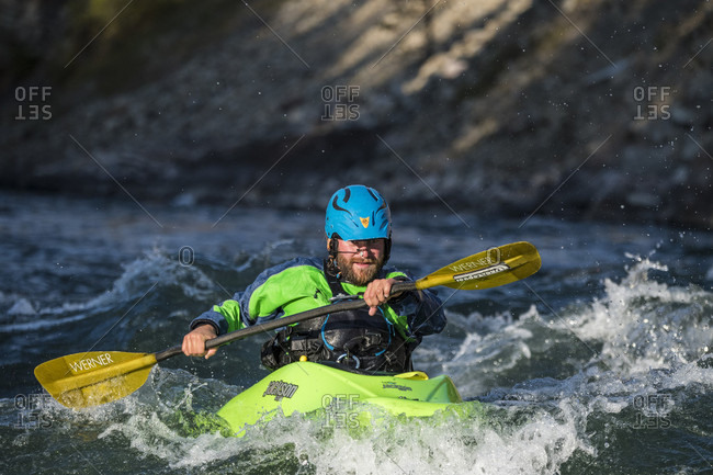 Jackson Hole, WY, USA - September 20, 2016: Front view of kayaker paddling on Snake River, Jackson Hole, Wyoming, USA