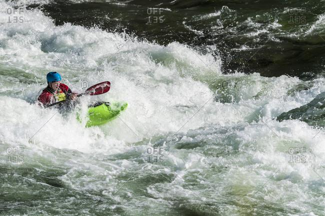 Jackson Hole, WY, USA - September 20, 2016: Kayaker paddling on white water in Snake River, Jackson Hole, Wyoming, USA
