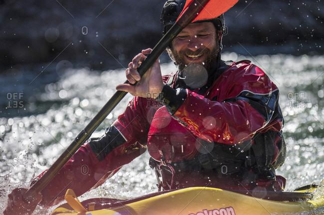 Jackson Hole, WY, USA - September 20, 2016: Close up of male kayaker smiling while kayaking on Snake River, Jackson Hole, Wyoming, USA