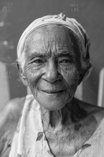 Baracoa, Baracoa, Cuba - March 18, 2017: Portrait of senior woman wearing headscarf and smiling, Baracoa, Cuba