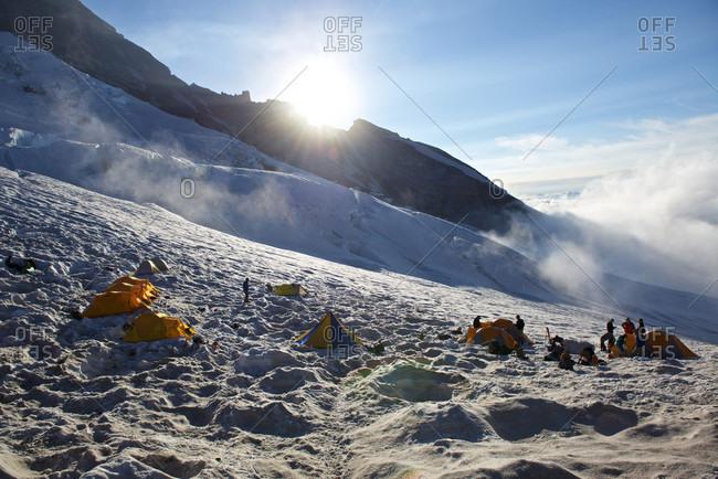 M, Washington, USA - July 23, 2017: Mountain climbers and tents at Camp Schurman on Mount Rainier, Mount Rainier National Park, Washington State, USA