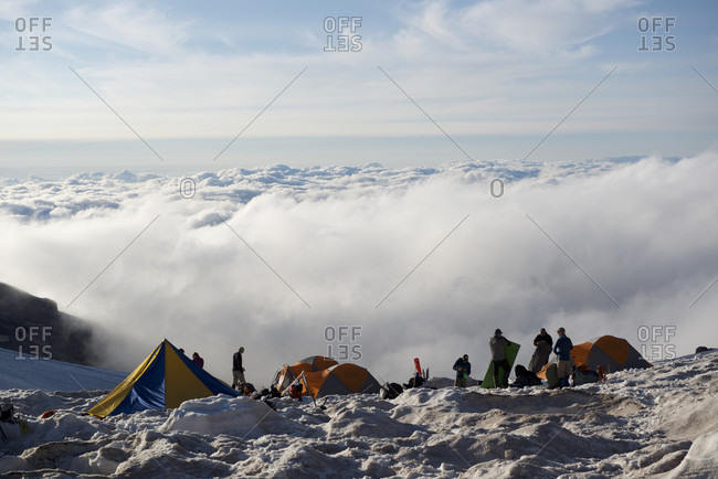 Mount Rainier National Park, Washington, USA - July 23, 2017: Mountain climbers and tents at Camp Schurman on Mount Rainier, Mount Rainier National Park, Washington State, USA