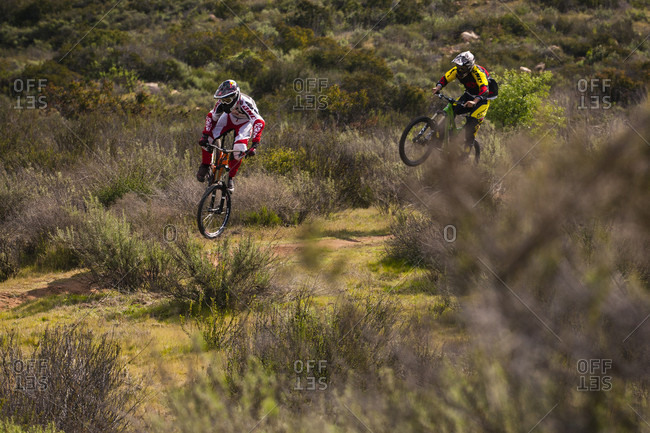 San Diego County, CA, USA - February 23, 2011: Two riders ride down a trail outside San Diego