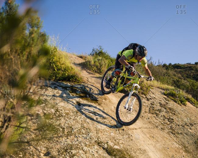 Laguna Hills, CA, USA - August 26, 2010: Richie Schley rides down a rock face