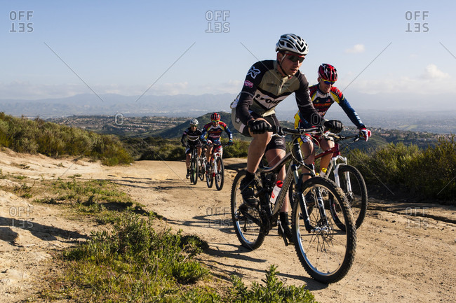 Southern California , California , USA - February 24, 2011: A group of cross country mountain bikers pedal uphill