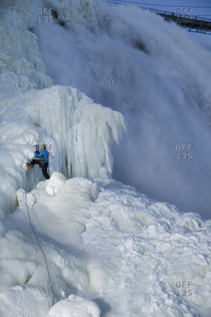 Quebec, Quebec, Canada - January 28, 2015: Ice climber climbing frozen Montmorency Falls in winter, Quebec, Canada