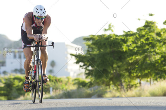 Los Cabos, Baja California, Mexico - October 25, 2015: Professional triathlete at bike stage of Los Cabos Iron Man 2015, Baja California, Mexico