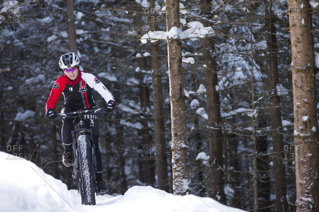 Quebec, Quebec, Canada - January 29, 2015: Rocky Mountain professional biker during winter training session on Fat Bike in mountain trail of Quebec, Canada