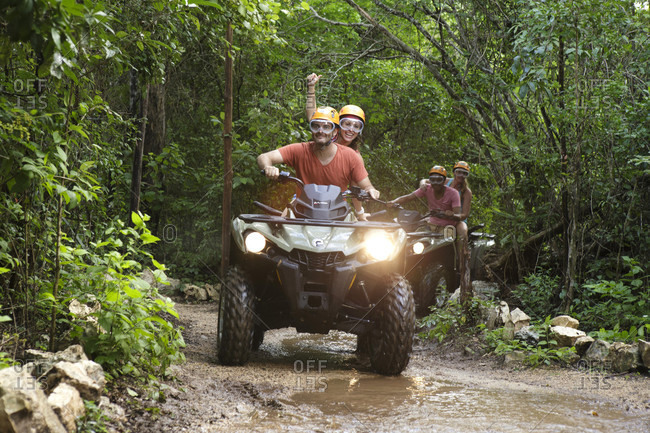 Emotions Park, Quintana Roo, Mexico - November 24, 2015: Front view of couples riding quad bikes in Emotions Native Park, Quintana Roo, Mexico