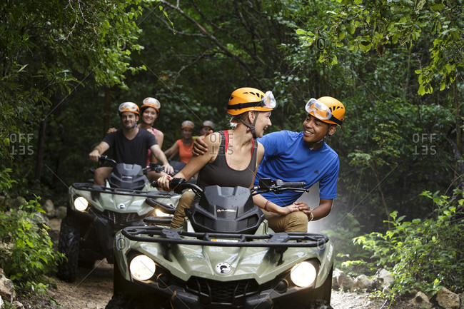 Emotions Park, Quintana Roo, Mexico - November 24, 2015: People riding quad bikes on Emotions Native Park dirt road, Quintana Roo, Mexico