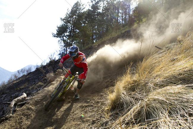 Tenango, State of Mexico, Mexico - April 2, 2016: Biker raising dust on downhill track, Tenango, State of Mexico, Mexico