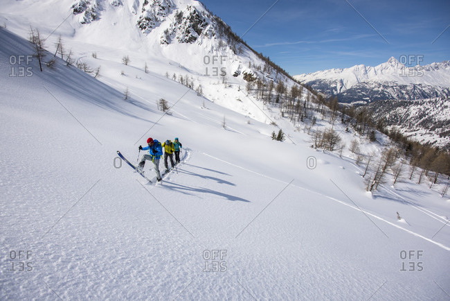Simplonpass, Valais, Switzerland - March 9, 2016: Group of people cross-country skiing in Swiss Alps, Simplon Pass, Valais Canton, Switzerland