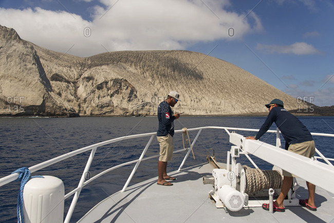 Revillagigedo Islands, Colima, Mexico - March 16, 2017: Sailors at bow of ship arriving at San Benedicto Island, Revillagigedo Islands, Colima, Mexico