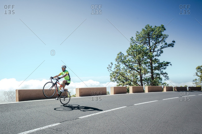 Tenerife, Canary Islands, Spain - April 16, 2016: Road cyclist doing wheelie, Tenerife, Canary Islands, Spain