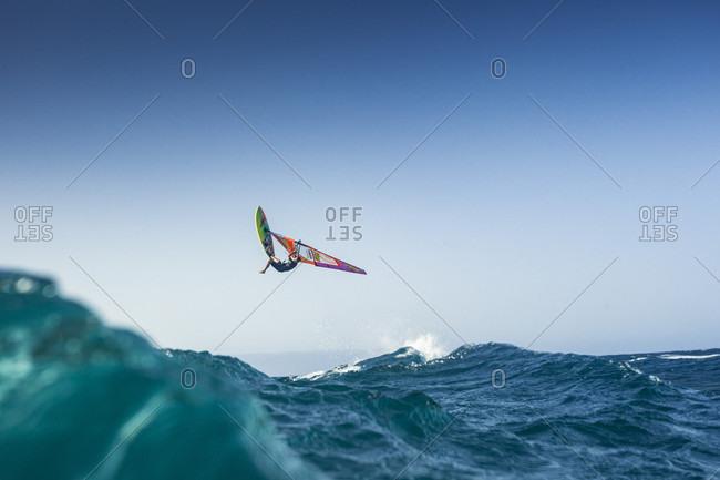 El Cabezo, Tenerife, Spain - July 29, 2016: Professional windsurfer in mid-air, El Cabezo, Tenerife, Canary Islands, Spain