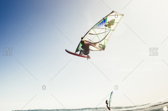 El Cabezo, Tenerife, Spain - February 16, 2018: Professional windsurfer in mid-air, El Cabezo, Tenerife, Canary Islands, Spain