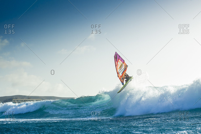 El Cabezo, Tenerife, Spain - July 29, 2016: Professional windsurfer jumping over wave, El Cabezo, Tenerife, Canary Islands, Spain