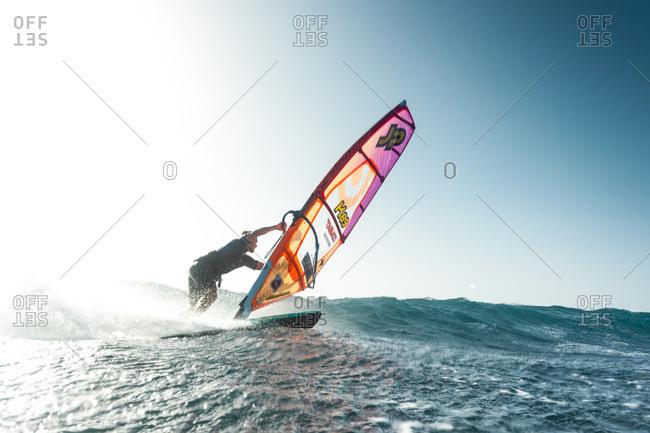 El Cabezo, Tenerife, Spain - July 29, 2016: Professional windsurfer on sea, El Cabezo, Tenerife, Canary Islands, Spain