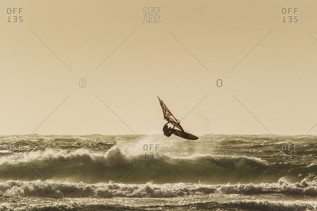 El Cabezo, Tenerife, Spain - February 16, 2018: Professional windsurfer jumping over wave, El Cabezo, Tenerife, Canary Islands, Spain