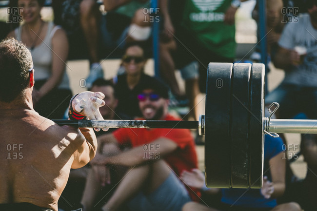 Tenerife, Spain - September 24, 2016: Athlete lifting weights during competition, Tenerife, Canary Islands, Spain