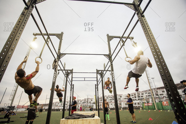Tenerife, Spain - September 26, 2015: Athletes doing ring dips during competition, Tenerife, Canary Islands, Spain