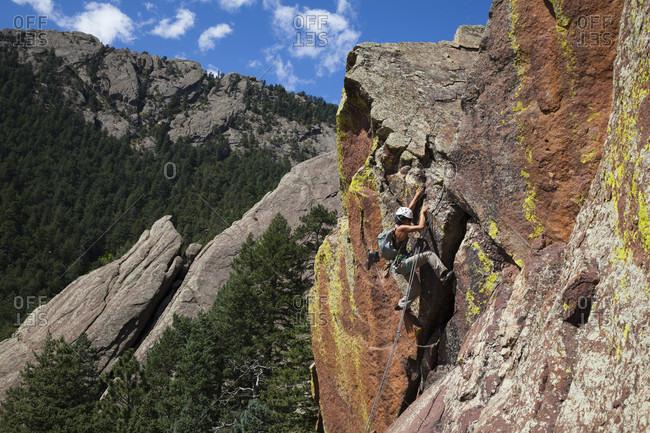 Boulder, Colorado, USA - September 6, 2015: Female rock climber at Angels Way (52) in Flatirons, Boulder, Colorado, USA