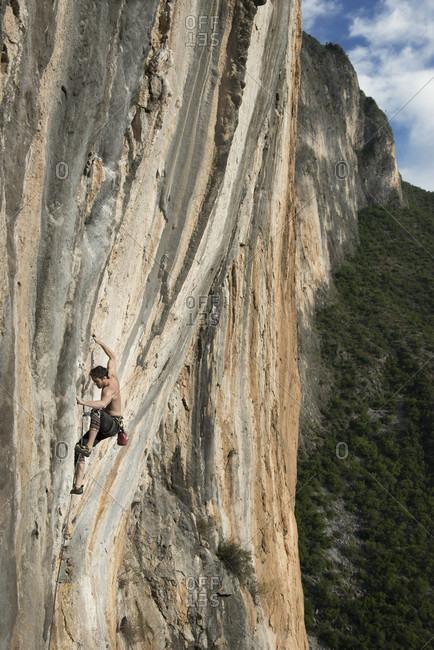El Potrero Chico, Monterrey, Mexico - December 25, 2014: Rock climber climbing cliff at Celestial Omnibus (512a) climbing route of El Portero Chico, Monterrey, Mexico
